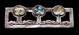 Brooch containing abalone pieces set in silver.  Its large size suggests it was probably designed to secure a cloak.  E.S. is stamped on it.  Dated c.1900.  Reproduced courtesy of the Tadema Gallery.  For other examples of Edgar Simpson's work see  www.tademagallery.com.