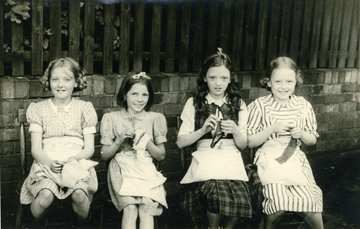 A group photograph taken at Lenton Church School in the late 1950s. Left to right: Mary Hodson, Marlene Dean, Jean Woolley and Ann Hart